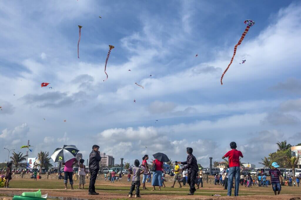 Image of Children fly a colourful variety of kites Galle Face Sri Lanka.