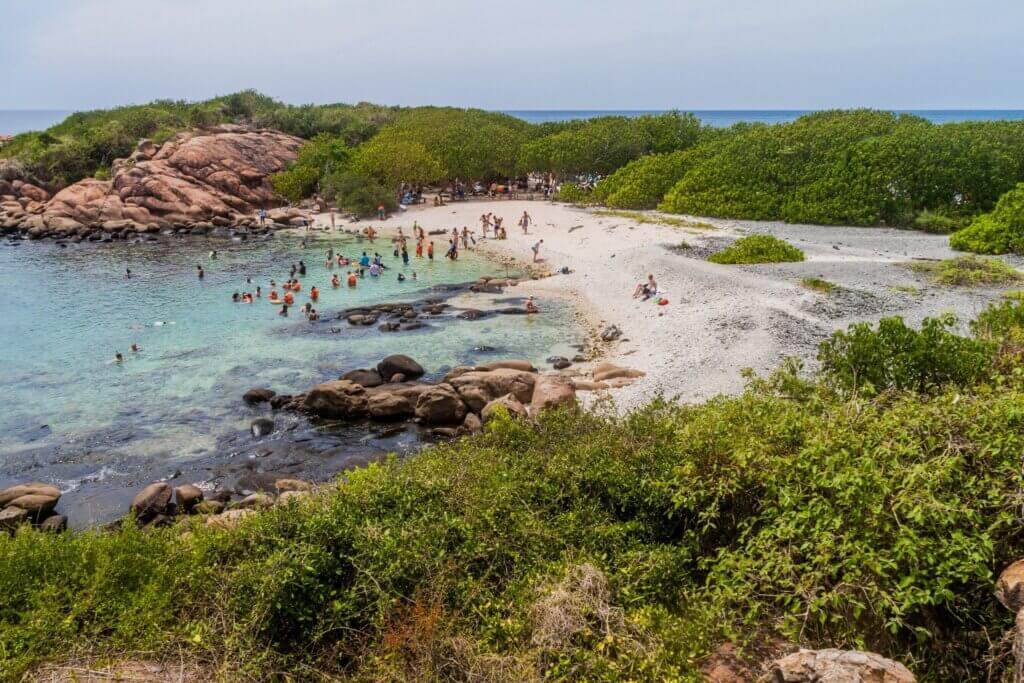 Image of People on a beach in Pigeon Island