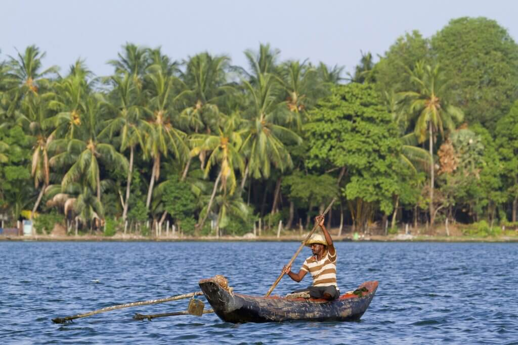 Image of Traditional fisherman in dugout canoe Batticalao