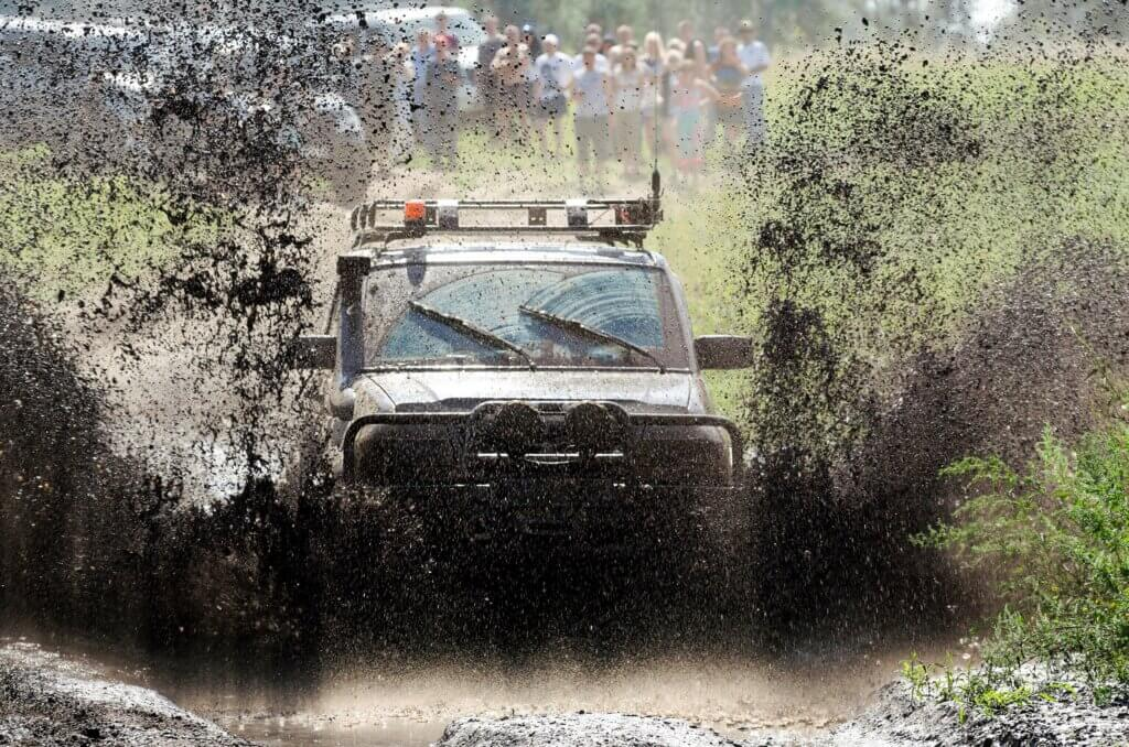 Image of 4x4 Off-road car in a puddle making mud splashes