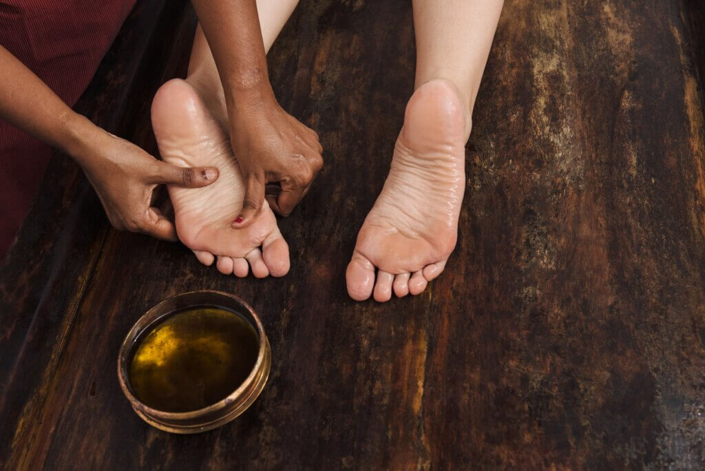 Image of Ayurveda foot massage with oil