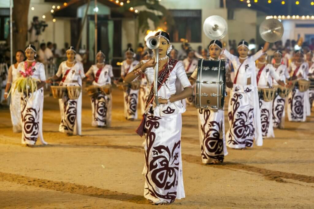 Image of Band of female musicians including a drummer perform Kataragama Festival