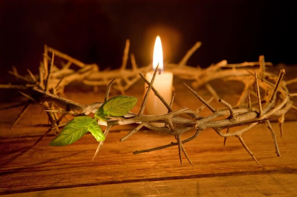 Image of Candle burning in the middle of a crown of thorns at easter sri lanka