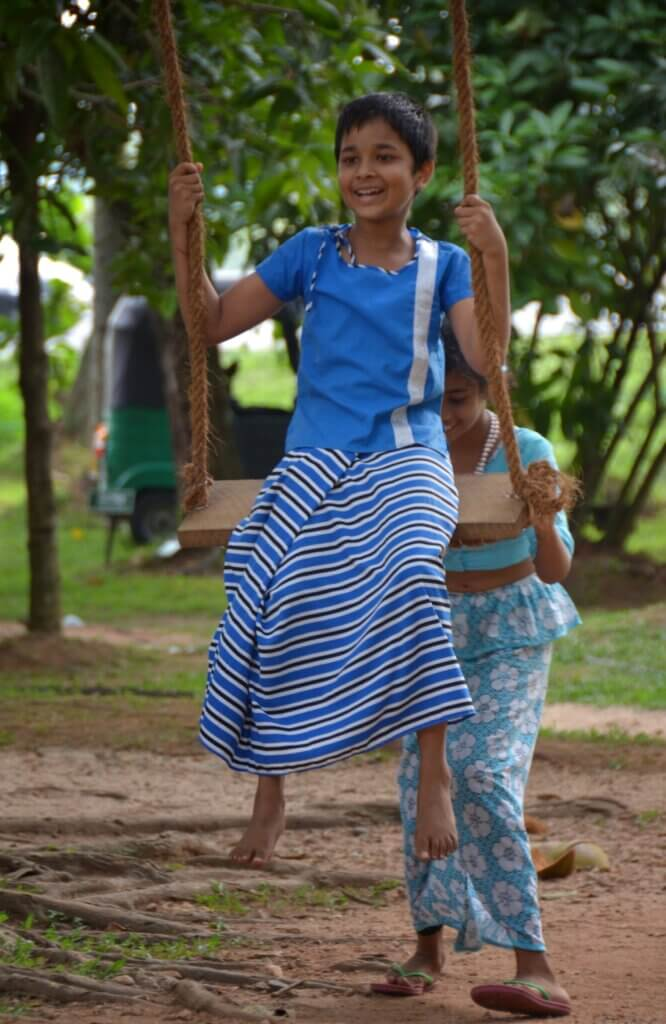 Image of Children Playing on Onchila During Sinhala and Tamil New Year Celebrations