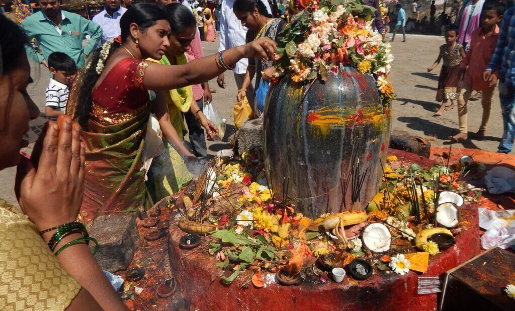 Image of Hindus perform Puja to lord Shiva stone statue