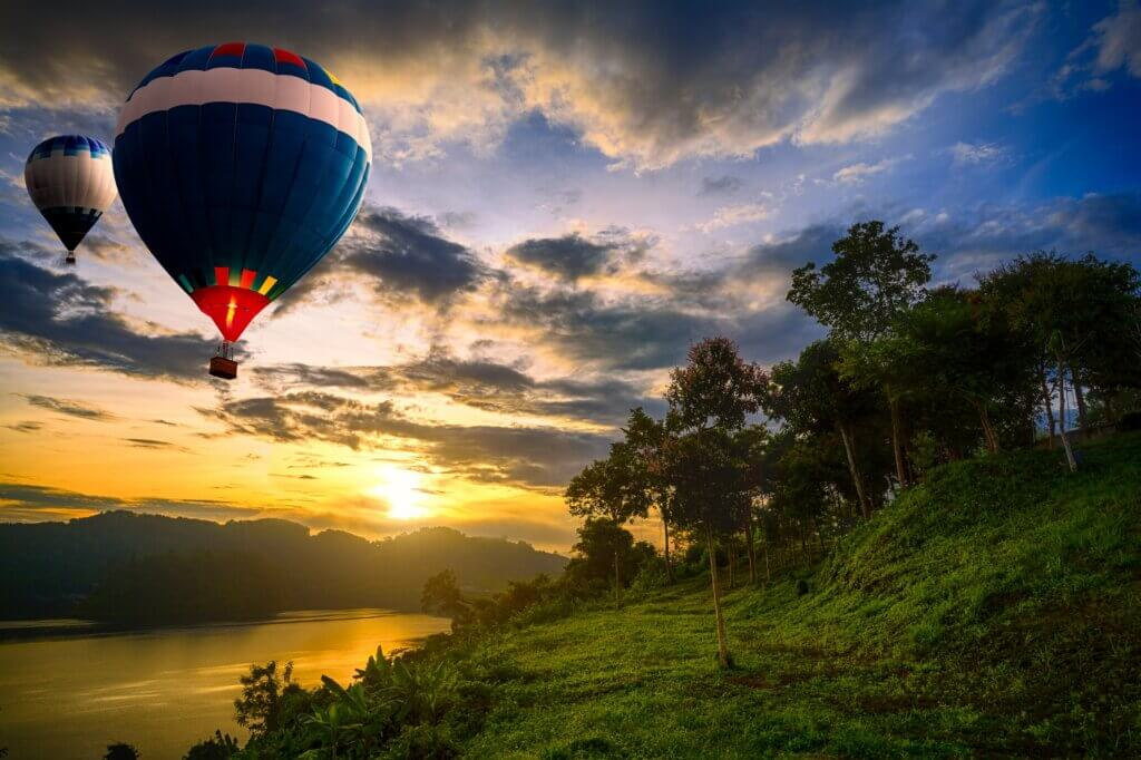 Image of Hot air balloons floating over lake in sri lanka