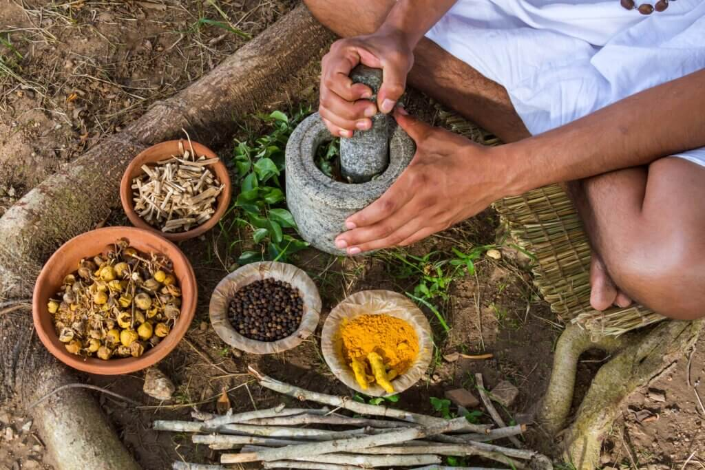 Image of Man preparing ayurvedic medicine in the traditional manner