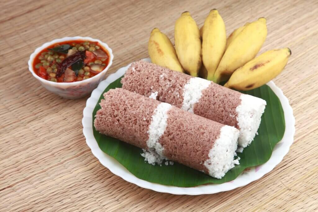 Image of Puttu with curry and a bunch of banana sri lanka