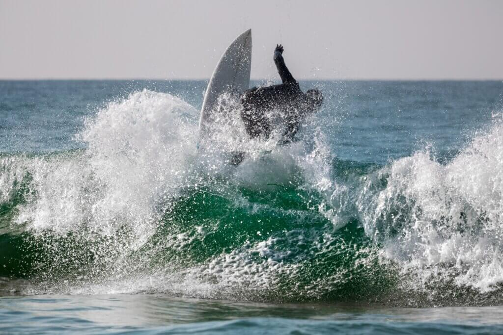 Image of Surfing riding the wave with lots of splashes
