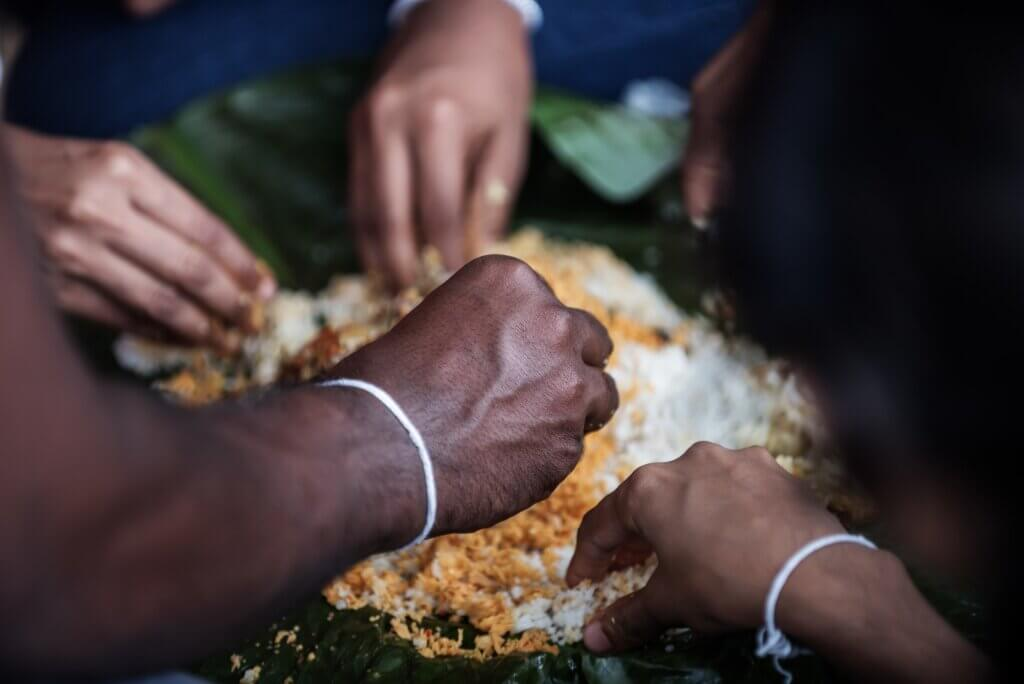 Image of family members eating traditional lunch sri lanka