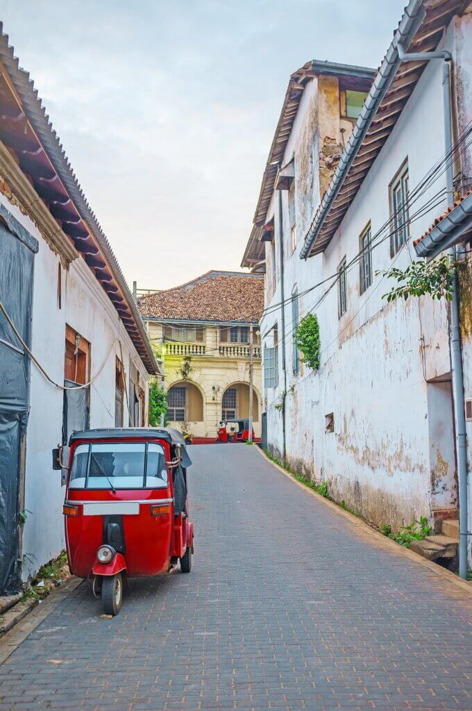 Image of Galle Fort with parked red tuk tuk