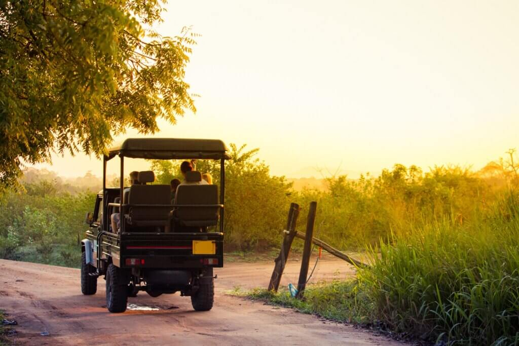 Image of Jeep carries tourists into the national park of Udawalawe