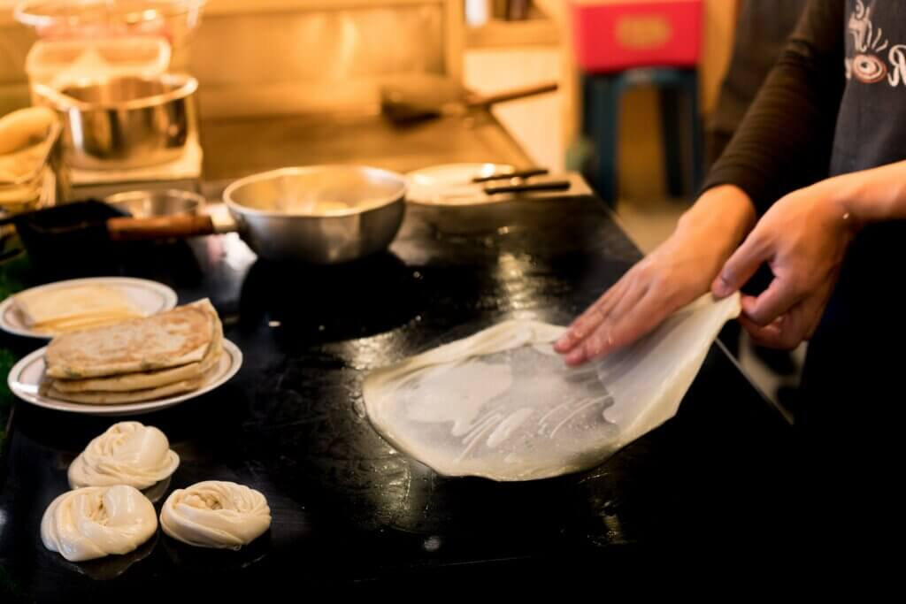 Image of Roti is a flatbread originating from the Indian subcontinent