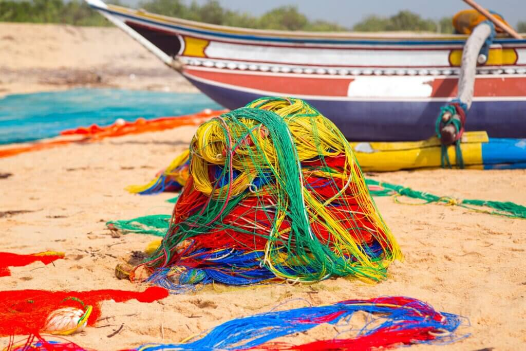 Image of fishing boat and fishing net on the ocean coast