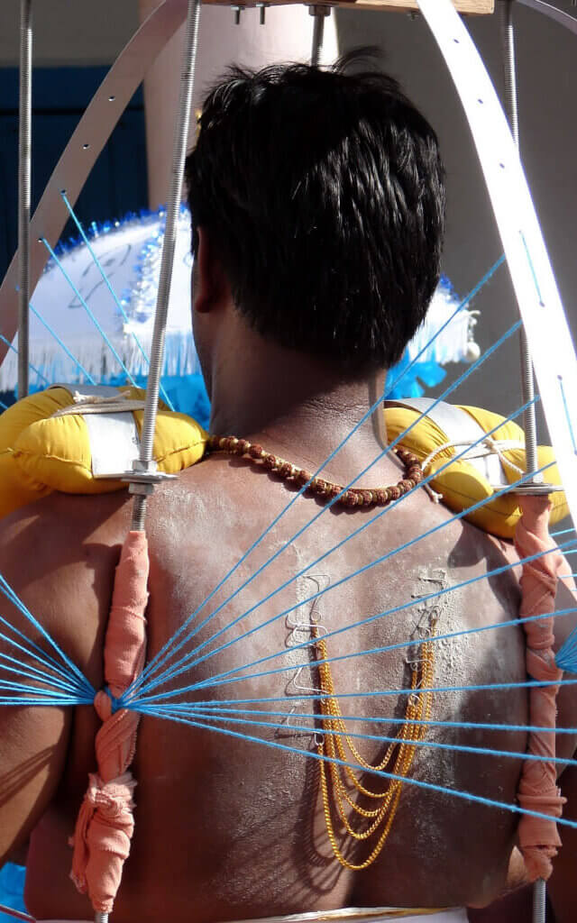 Image of Indian devotee with Kavadi bearing for Thaipusam celebration